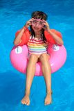Girl In Inflatable Ring Royalty Free Stock Images