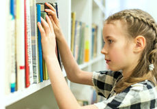 Girl In Library. Royalty Free Stock Photography