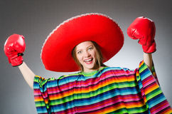 Free Girl In Mexican Vivid Poncho And Box Gloves Royalty Free Stock Images - 62466619