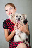 Girl In Red And Dog Stock Photography