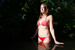 Free Girl In Red Bikini In Dark Water Stock Photography - 58104602