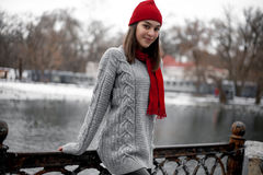 Girl In Red Hat And Scarf Walking In Winter Park Near Lake. Royalty Free Stock Photography