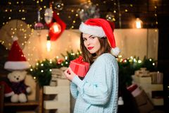 Free Girl In Santa Claus Hat. Christmas Shopping. Christmas Tree. Winter Holiday. Sexy Woman With Present Box. Happy New Year Royalty Free Stock Images - 160572079
