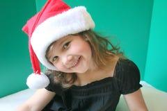 Girl In Santa Hat Stock Image