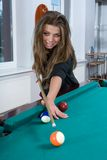 Girl In Short Skirt Playing Snooker Royalty Free Stock Image