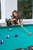 Girl In Short Skirt Playing Snooker Royalty Free Stock Photography