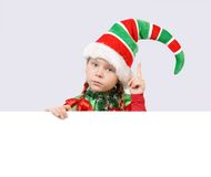 Girl In Suit Of Christmas Elf With The Banner Stock Photography