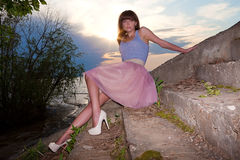 Girl In Summer Dress On Dirty Concrete Stairs Royalty Free Stock Photos