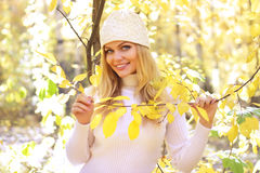 Girl In The Autumn Forest Stock Images