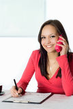 Girl In The Red With The Phone Stock Photos