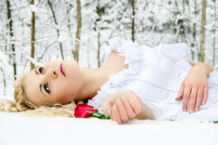 Girl In Winter Forest With A Rose Royalty Free Stock Photo