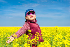 Girl In Yellow Field Of Stock Photo