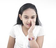 Girl of indian origin whispering Royalty Free Stock Photography