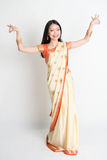 Girl in Indian sari dress dancing Stock Images