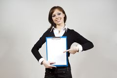 Girl indicates standing on the document Royalty Free Stock Photography