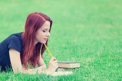 Girl in indie style clothes with books Stock Photos