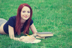Girl in indie style clothes with books Stock Photography
