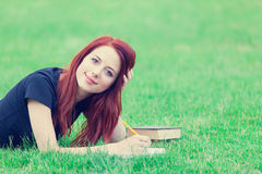 Girl in indie style clothes with books Royalty Free Stock Photo