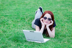 Girl in indie style clothes with laptop computer Stock Image