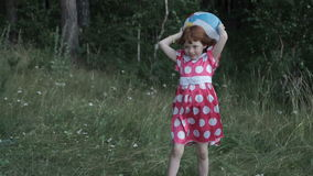 Girl with inflatable ball on meadow stock video footage