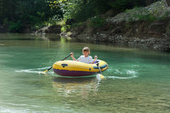 Girl in inflatable boat Stock Images