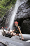 The girl an inflatable boat at waterfalls Stock Images
