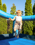 Girl in inflatable playground Stock Photo