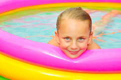 Girl in inflatable pool. Little girl in inflatable pool Royalty Free Stock Images