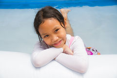 Girl and Inflatable pool Stock Photography