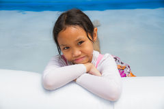 Girl and Inflatable pool Royalty Free Stock Photos