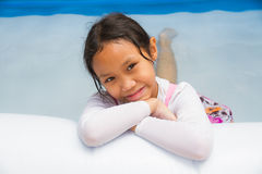 Girl and Inflatable pool Stock Photo