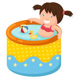 A girl in inflatable pool Stock Photo
