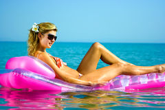 Girl on inflatable raft Stock Photos