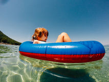 Girl in inflatable raft Royalty Free Stock Photos