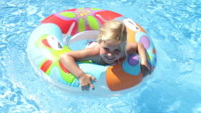 Girl in inflatable rubber ring  Royalty Free Stock Photos