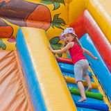 Girl on inflatable slides Royalty Free Stock Image