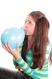 Girl Inflates A Balloon, Isolated. Royalty Free Stock Image