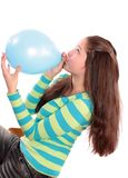 Girl inflates a balloon. Stock Photography