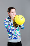 Girl inflating a balloon Royalty Free Stock Photo