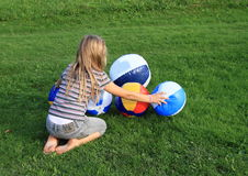 Girl with inflating balls Stock Photo