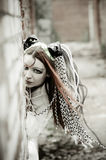 Girl in the informal style poses for the Royalty Free Stock Images
