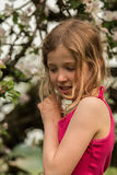 Girl infront of appletree Royalty Free Stock Photos
