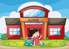 Girl infront of school Stock Image
