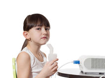 Girl inhaled. Portrait of young caucasian girl using inhaler isolated on white Stock Images