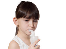 Girl inhaled. Portrait of young caucasian girl using inhaler isolated on white Stock Photo