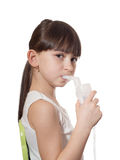 Girl inhaled. Portrait of young caucasian girl using inhaler isolated on white Royalty Free Stock Image