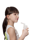 Girl inhaled. Portrait of young caucasian girl using inhaler isolated on white Royalty Free Stock Images