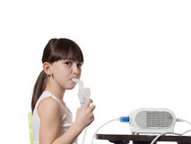 Girl inhaled. Portrait of young caucasian girl using inhaler isolated on white Royalty Free Stock Photos