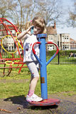 Girl with inhaler. Little girl on the playground with blue inhaler Stock Photo