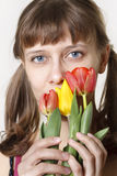 The girl inhales aroma of tulips Royalty Free Stock Photos
